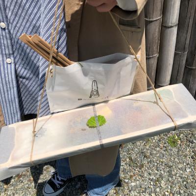 米ギャラリー大手前の青竹弁当を持った画像